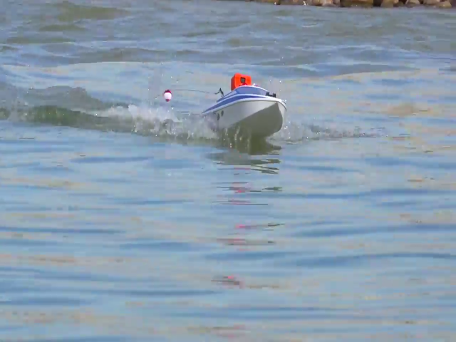 Watch this guy land a pike with an rc boat reelerz for Fish catching rc boat